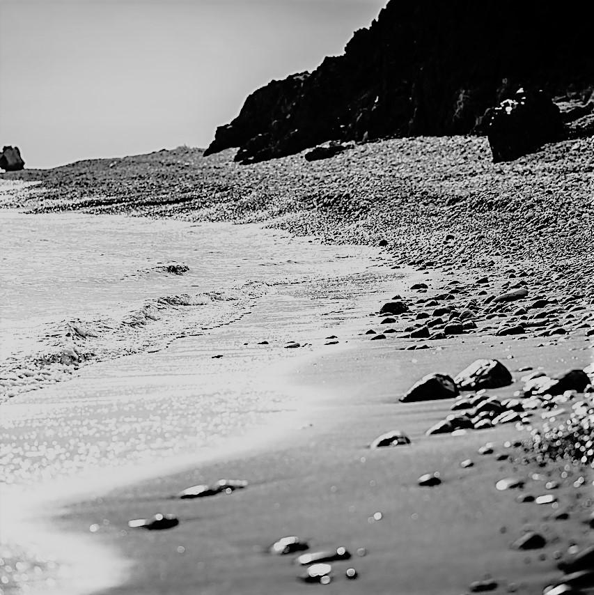 Strand und Steine ls Sinnbild für einen Motivationsspruch